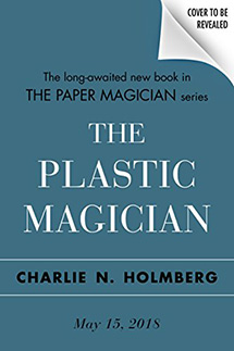 "A blue cover with ""The Plastic Magician"" in white text; release date May 15, 2018"